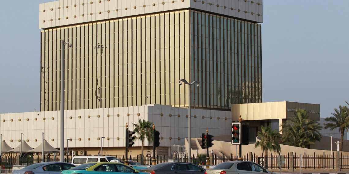 Cars drive past the building of Qatar Central Bank in Doha, Qatar, June 6, 2017. REUTERS/Naseem Zeitoon
