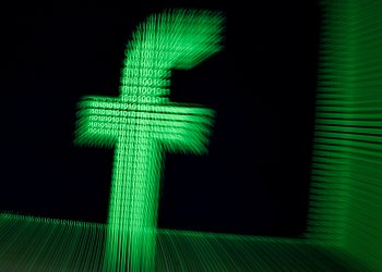 FILE PHOTO: A 3D-printed Facebook logo is seen in front of displayed binary digits in this illustration taken March 18, 2018. REUTERS/Dado Ruvic/Illustration/File Photo