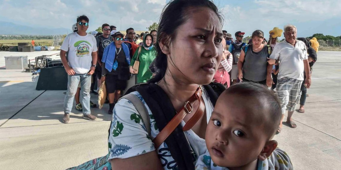 People injured or affected by the earthquake and tsunami wait to be evacuated on an air force plane in Palu, Central Sulawesi, Indonesia, September 30, 2018. Antara Foto/Muhammad Adimaja via REUTERS