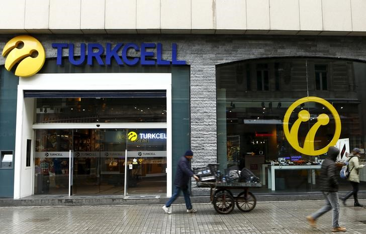 FILE PHOTO: Pedestrians walk past by the main Turkcell shop in central Istanbul, Turkey, January 18, 2016. REUTERS/Murad Sezer