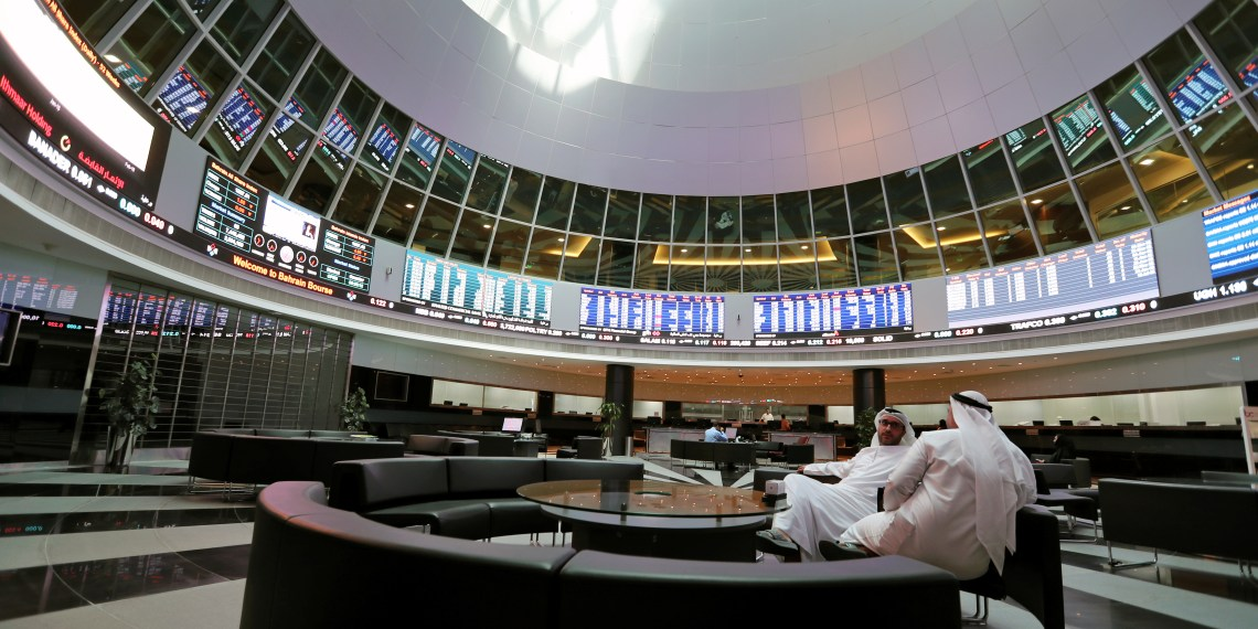 FILE PHOTO: Traders look at the screens at Bahrain Bourse in Manama, Bahrain, February 7, 2018. REUTERS/Hamad I Mohammed