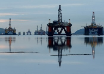 FILE PHOTO: Drilling rigs are parked up in the Cromarty Firth near Invergordon, Scotland, Britain January 27, 2015. REUTERS/Russell Cheyne/File Photo