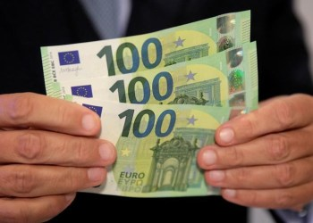 FILE PHOTO: An Austrian central bank official displays new 100 euro banknotes in Vienna, Austria, September 17, 2018. REUTERS/Heinz-Peter Bader