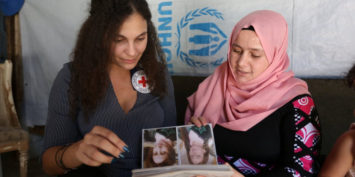 Syrian refugee Hana al-Ali, 30, with Sarah Joe Chamate, a psychologist with the International Committee of Red Cross (ICRC), in Bar Elias town, in the Bekaa valley, Lebanon July 20, 2018. REUTERS/Aziz Taher