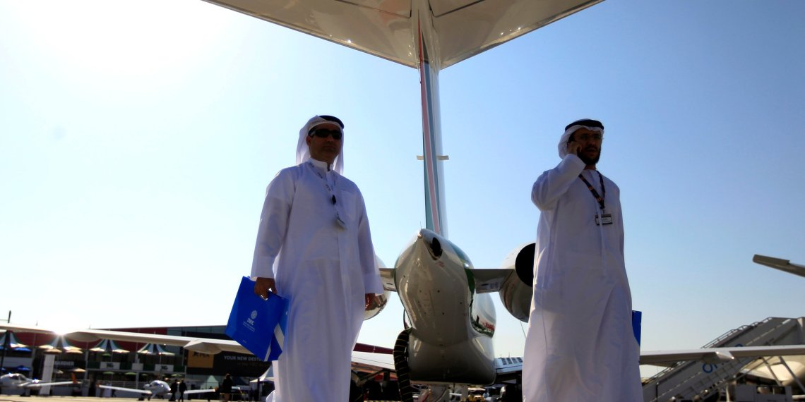 FILE PHOTO: Visitors walk past aircraft on display during the Middle East Business Aviation show at Al Maktoum International Airport in Dubai World Central, December 11, 2012. REUTERS/Jumana El Heloueh/File Photo