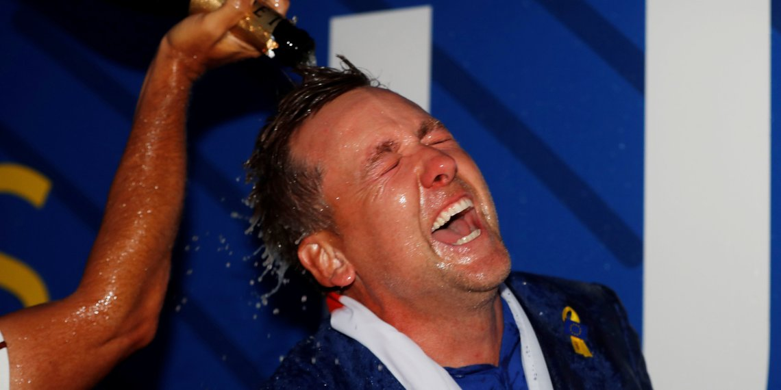 FILE PHOTO: Golf - 2018 Ryder Cup at Le Golf National - Guyancourt, France - September 30, 2018 - Team Europe's Ian Poulter celebrates after winning the Ryder Cup REUTERS/Paul Childs/File Photo