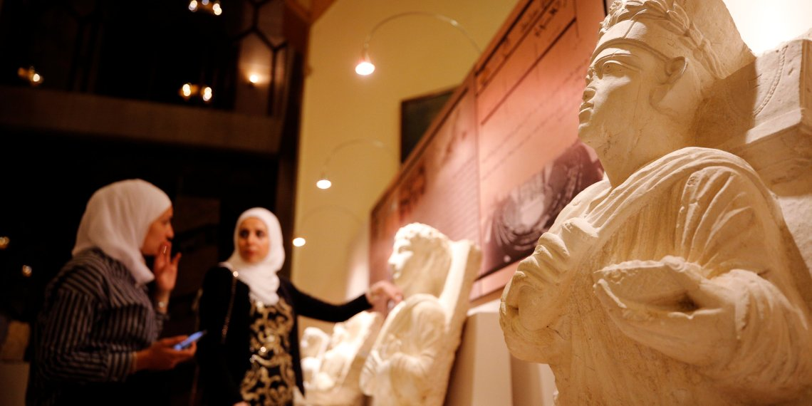 Visitors look at restored sculptures in an exhibition, at the Opera house in Damascus, Syria October 3, 2018. REUTERS/Omar Sanadiki
