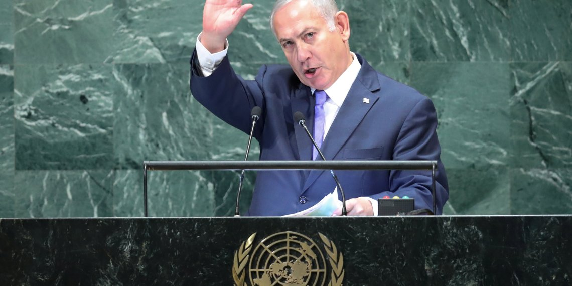 FILE PHOTO: Israeli Prime Minister Benjamin Netanyahu waves after his address to the 73rd session of the United Nations General Assembly at U.N. headquarters in New York, U.S., September 27, 2018. REUTERS/Carlo Allegri