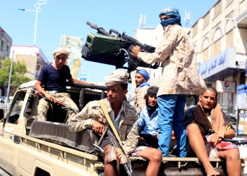 Government soldiers ride on the back of a patrol truck on a street where people demonstrated against the deterioration of Yemen's economy and the devaluation of the local currency in Taiz, Yemen October 6, 2018. REUTERS/Anees Mahyoub