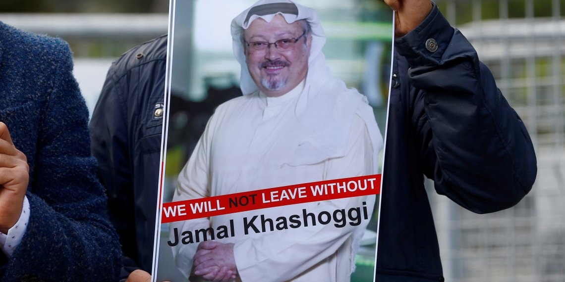 FILE PHOTO: A demonstrator holds picture of Saudi journalist Jamal Khashoggi during a protest in front of Saudi Arabia's consulate in Istanbul, Turkey, October 5, 2018. REUTERS/Osman Orsal/File Photo