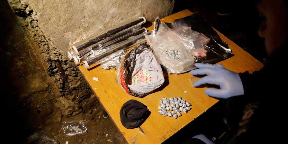 FILE PHOTO: A Turkish anti-narcotics police officer counts confiscated narcotics during a drug raid in Istanbul, Turkey, January 16, 2018. REUTERS/Osman Orsal/File Photo