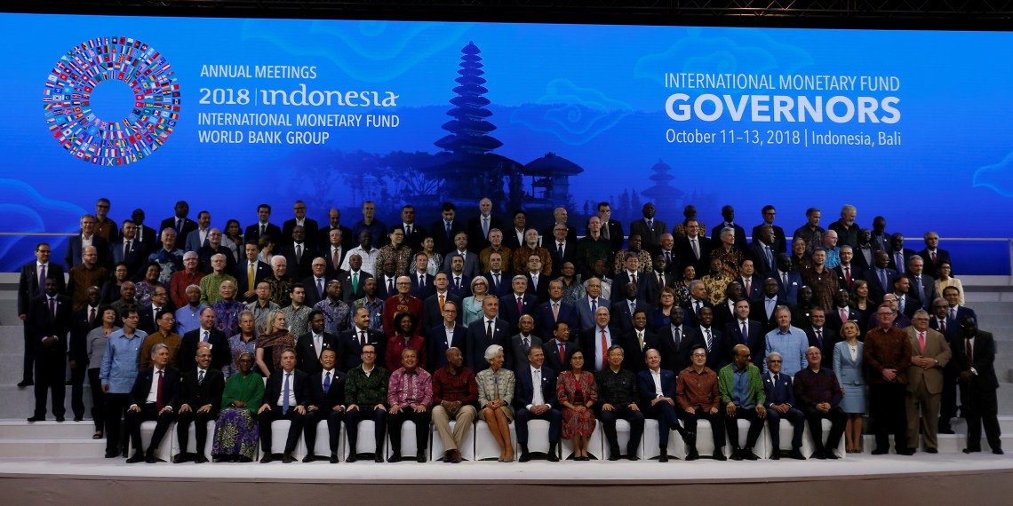 IMF Managing Director Christine Lagarde (CF), Central Bank governors and finance ministers pose for a group photo at the International Monetary Fund - World Bank Group Annual Meeting 2018 in Nusa Dua, Bali, Indonesia October 13, 2018. REUTERS/Johannes P. Christo