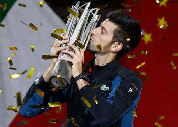 Tennis - Shanghai Masters - Men's Singles - Qi Zhong Tennis Center, Shanghai, China - October 14, 2018. Novak Djokovic of Serbia celebrates with the trophy after winning the final against Borna Coric of Croatia. REUTERS/Aly Song