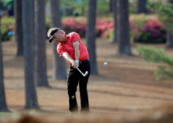 FILE PHOTO: Bernhard Langer of Germany hits on the 17th fairway during first round play of the 2018 Masters golf tournament at the Augusta National Golf Club in Augusta, Georgia, U.S., April 5, 2018. REUTERS/Brian Snyder/File Photo