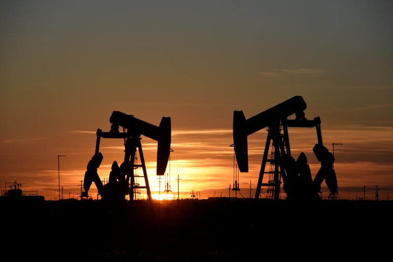 FILE PHOTO: Pump jacks operate at sunset in an oilfield in Midland, Texas U.S. August 22, 2018. REUTERS/Nick Oxford/File Photo