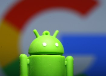 A 3D printed Android mascot Bugdroid is seen in front of a Google logo in this illustration taken July 9, 2017. REUTERS/Dado Ruvic/Illustration