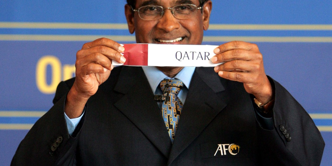 """FILE PHOTO: Asian Football Confederation (AFC) General Secretary Peter Velappan shows a piece of paper bearing """"Qatar"""" during the draw for the AFC Asian Cup 2007 qualifiers competition in Kuala Lumpur January 4, 2006. REUTERS/Fadi AL-Assaad"""