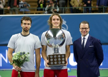 Tennis - ATP Stockholm Open - Men's Single Final - Stockholm, Sweden - October 21 2018. Stefanos Tsitsipas of Greece poses with his trophy next to Sweden's Prince Daniel after winning the ATP Stockholm Open tennis tournament men's single final against Ernests Gulbis of Latvia (L). TT News Agency/Soren Andersson/via REUTERS