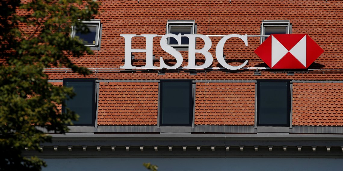 FILE PHOTO: A logo is pictured on HSBC bank in Geneva, Switzerland, August 16, 2018. REUTERS/Denis Balibouse
