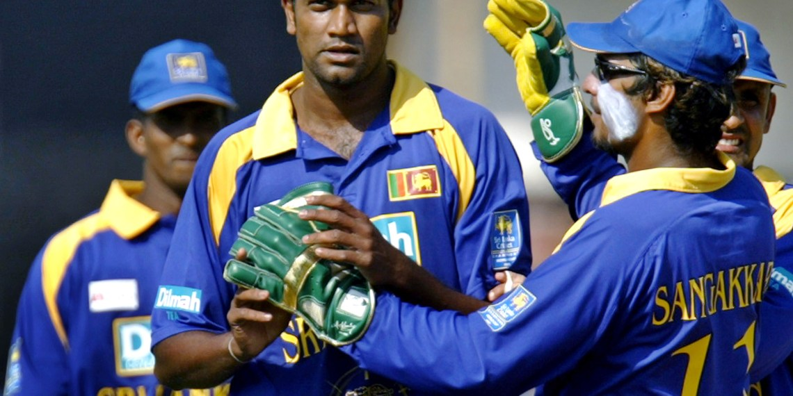 FILE PHOTO - Sri Lanka's Nuwan Zoysa (C) celebrates with wicketkeeper Kumar Sangakkara (R) after taking the wicket of India's Sachin Tendulkar during the seventh and final one-day international in Vadodra, 105 Km (66 miles) southwest of the western Indian city of Ahmedabad November 12, 2005. REUTERS/Punit Paranjpe