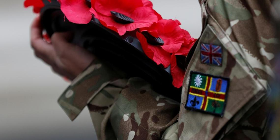 An army cadet holds a poppy wreath during the Western Front Association service at the Cenotaph to remember servicemen and women killed conflict, in London, Britain November 11, 2017. REUTERS/Peter Nicholls