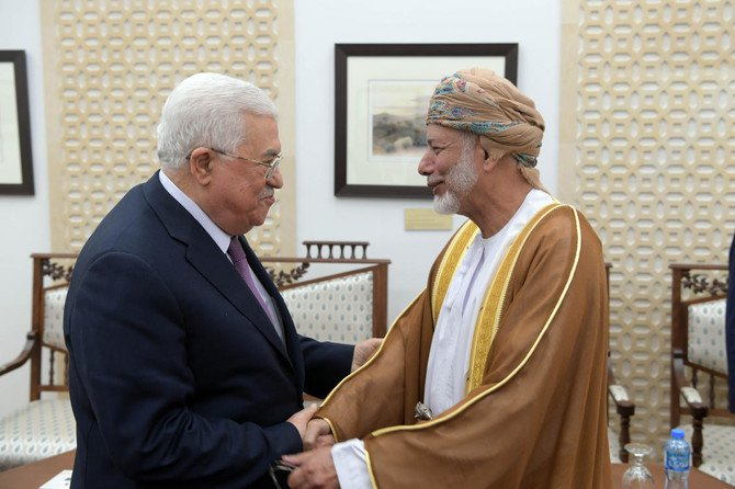 A handout picture released by the Palestinian Authority's Press office (PPO) shows Palestinian president Mahmud Abbas during his meeting on October 31, 2018 with Omani minister responsible for foreign affairs, Yussef bin Alawi bin Abdullah, in the West Bank city of Ramallah. (AFP)