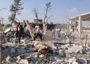 The deaths occurred in the town of Jarjanaz, which lies on the inner edge of the 15-20km demilitarization zone, has been a target of Syrian government attacks such as this one on September 20 last year. (AFP)