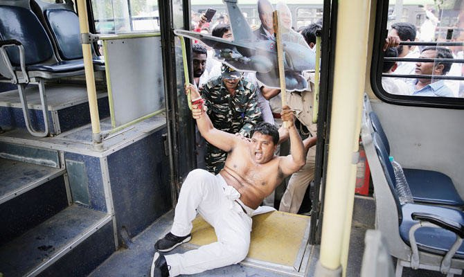 A Congress party worker is being detained during an anti-government protest in New Delhi. (AP)
