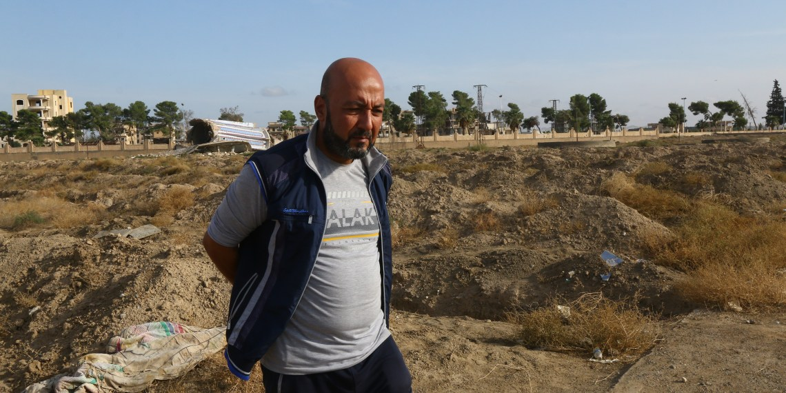 Sajed Salameh stands near a mass grave in Raqqa, Syria October 21, 2018. Picture taken October 21, 2018. REUTERS/Aboud Hamam