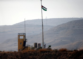 A Jordanian soldier pulls a Jordanian national flag in an outpost at the border area between Israel and Jordan at Naharayim, as seen from the Israeli side October 22, 2018. REUTERS/ Ronen Zvulun