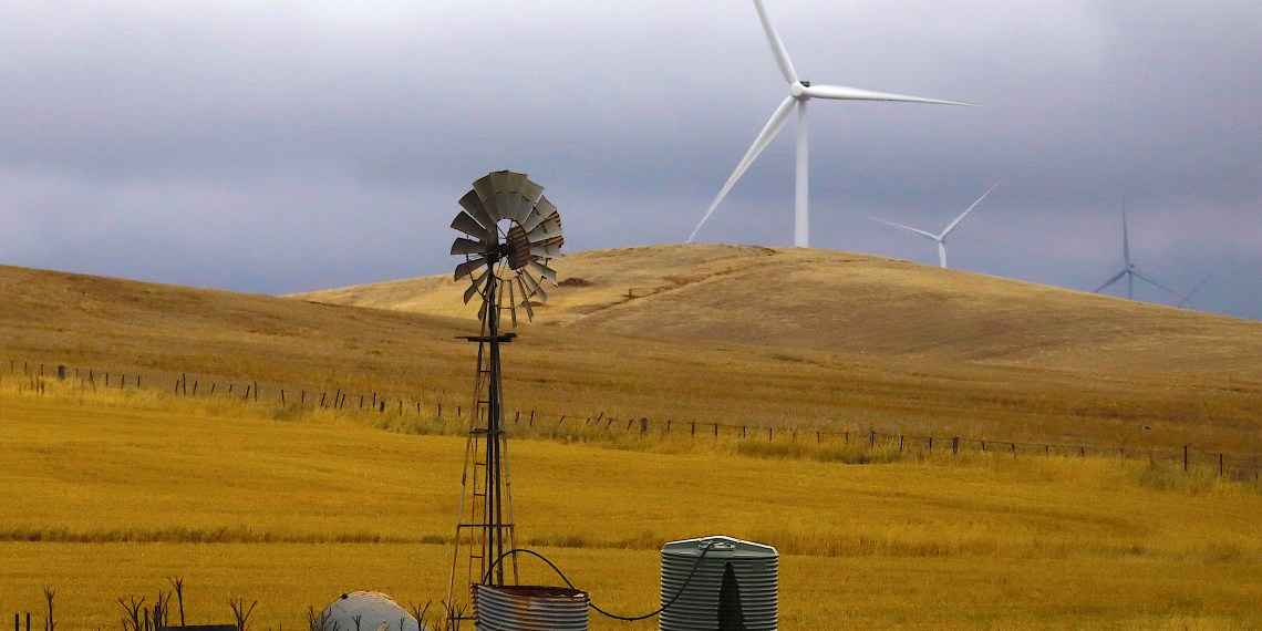 FILE PHOTO: An old windmill stands in front of wind turbines in a paddock near the Hornsdale Power Reserve, featuring the world's largest lithium ion battery made by Tesla, located on the outskirts of the South Australian town of Jamestown, in Australia, December 1, 2017. REUTERS/David Gray/File Photo