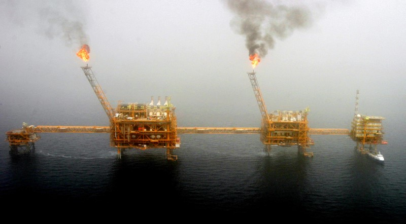 FILE PHOTO: Gas flares from an oil production platform at the Soroush oil fields in the Persian Gulf, south of the capital Tehran, July 25, 2005. REUTERS/Raheb Homavandi