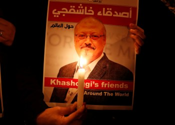 FILE PHOTO: A demonstrator holds a poster with a picture of Saudi journalist Jamal Khashoggi outside the Saudi Arabia consulate in Istanbul, Turkey October 25, 2018. REUTERS/Osman Orsal
