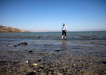 Israel's Minister of Energy and Water Resources, Yuval Steinitz, walks in the Sea of Galilee in northern Israel November 1, 2018. Picture taken November 1, 2018. REUTERS/Ronen Zvulun