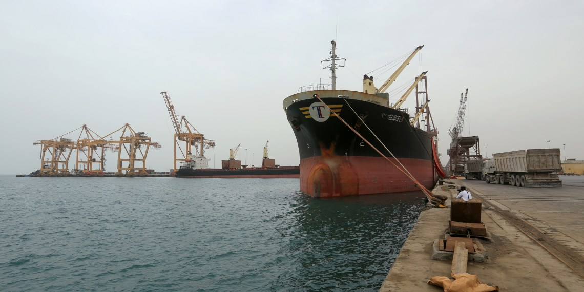 FILE PHOTO: A ship carrying a shipment of grain is docked at the Red Sea port of Hodeidah, Yemen August 5, 2018. REUTERS/Abduljabbar Zeyad