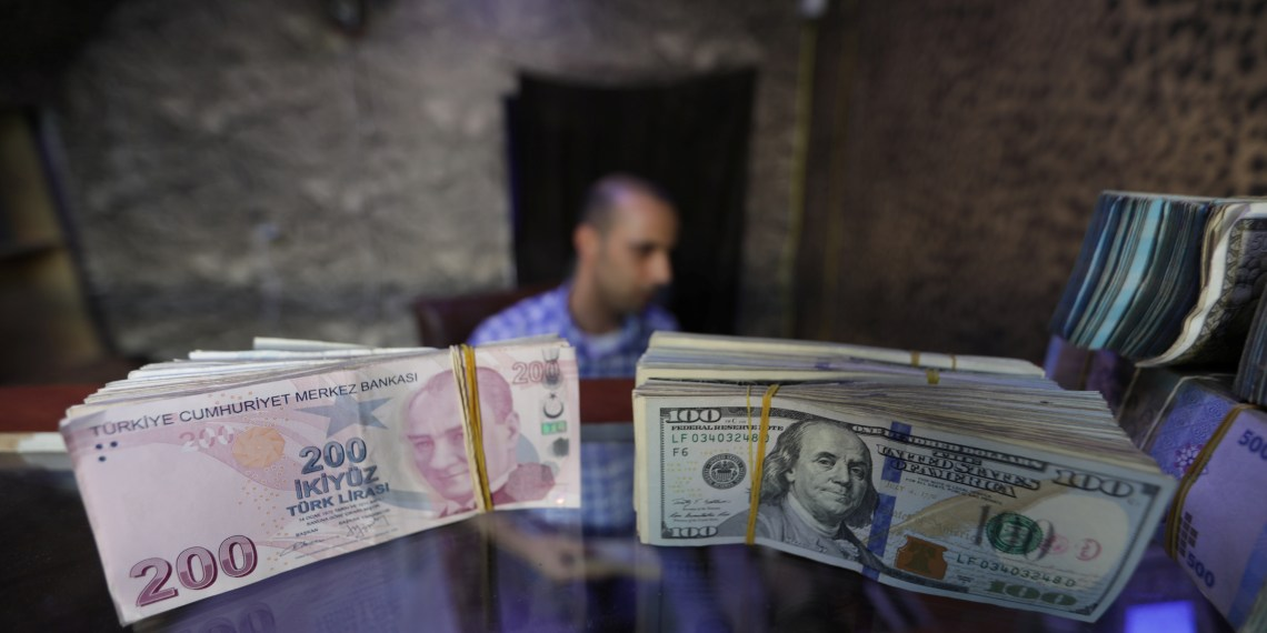FILE PHOTO: Banknotes of U.S. dollars and Turkish lira are seen in a currency exchange shop in the city of Azaz, Syria August 18, 2018. REUTERS/Khalil Ashawi