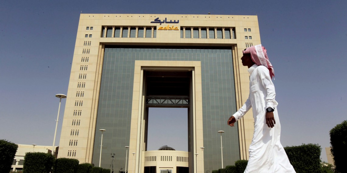 FILE PHOTO: A man walks past the headquarters of Saudi Basic Industries Corp (SABIC) in Riyadh, Saudi Arabia October 27, 2013. REUTERS/Faisal Al Nasser