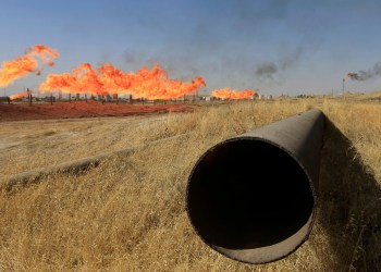 FILE PHOTO: Flames emerge from flare stacks at oilfields in Kirkuk, Iraq October 18, 2017. REUTERS/Alaa Al-Marjani/File Photo