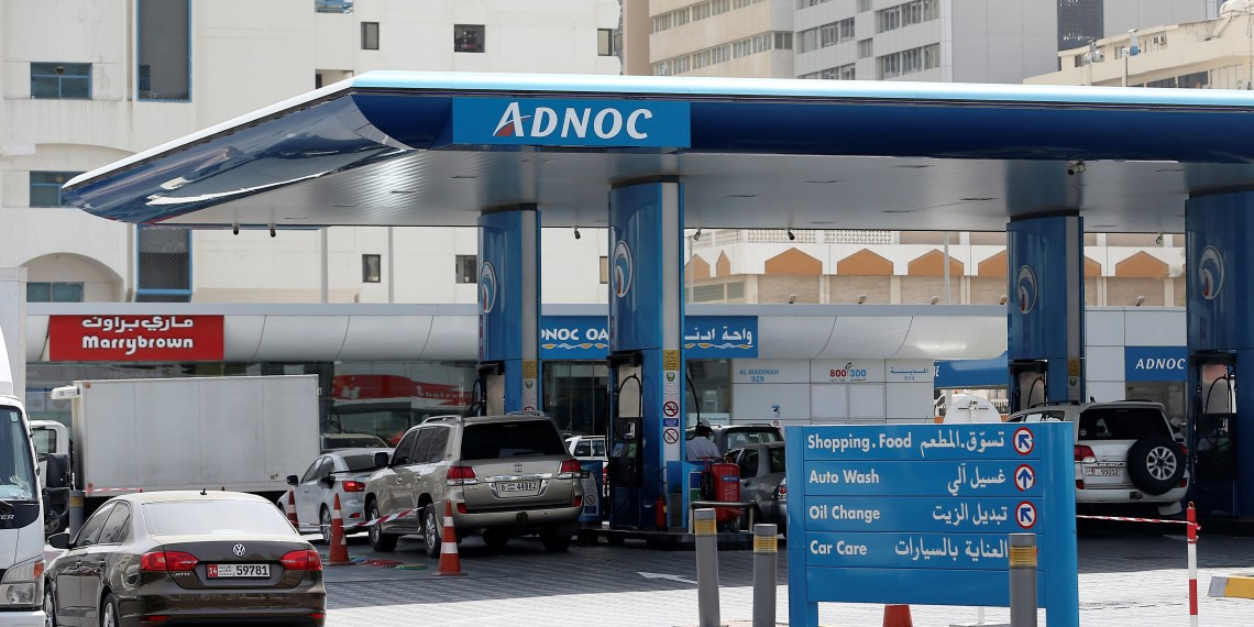 FILE PHOTO: Cars are seen an ADNOC petrol station in Abu Dhabi, United Arab Emirates July 10, 2017. REUTERS/Stringer