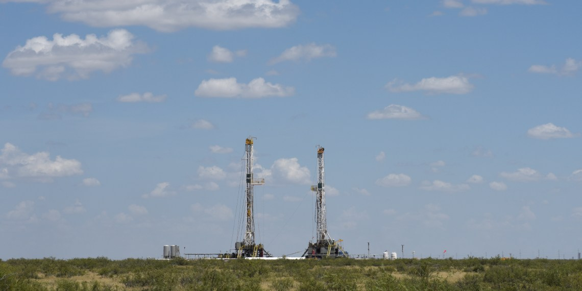 FILE PHOTO: Horizontal drilling rigs operate in the Permian Basin oil production area near Wink, Texas U.S. August 22, 2018. REUTERS/Nick Oxford