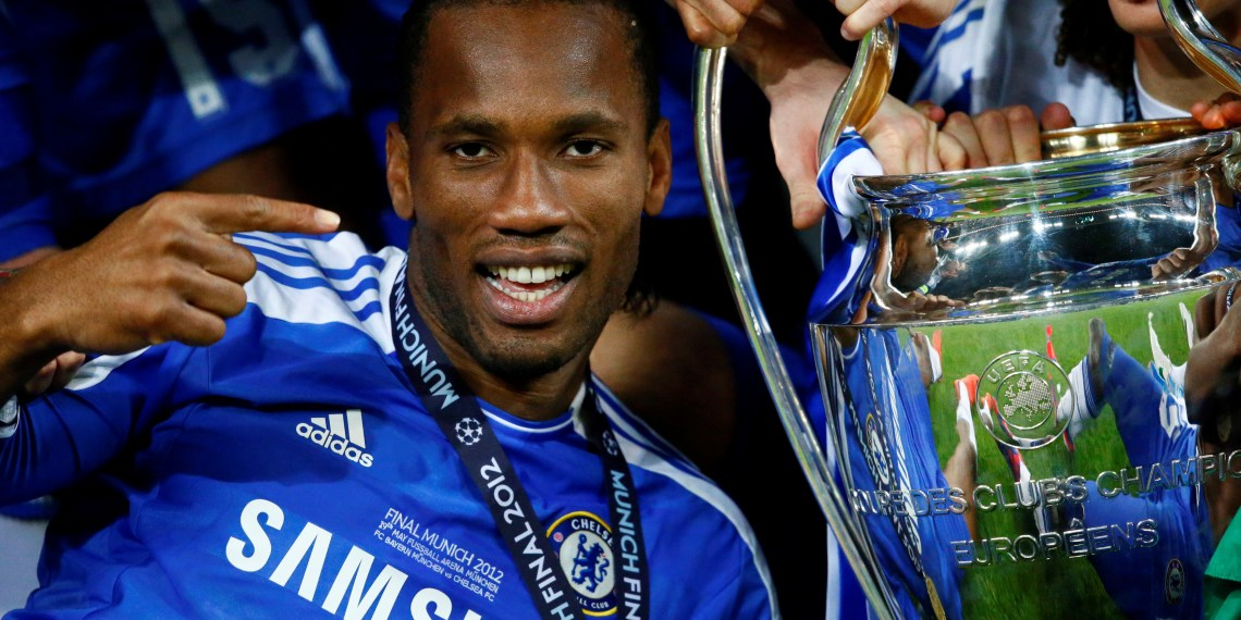 FILE PHOTO: Chelsea's Didier Drogba celebrates with the trophy after their Champions League final soccer match against Bayern Munich at the Allianz Arena in Munich May 19, 2012. REUTERS/Kai Pfaffenbach/File Photo