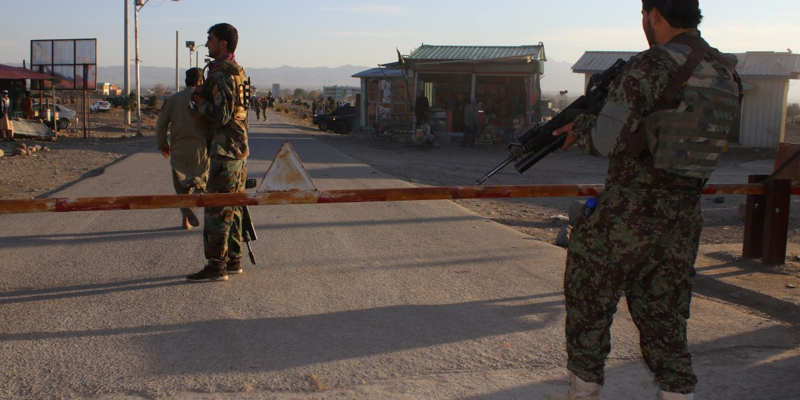 Afghan National Army (ANA) soldiers stand guard at the gate of an army base after a suicide blast in Khost province, Afghanistan November 23, 2018. REUTERS/Stringer