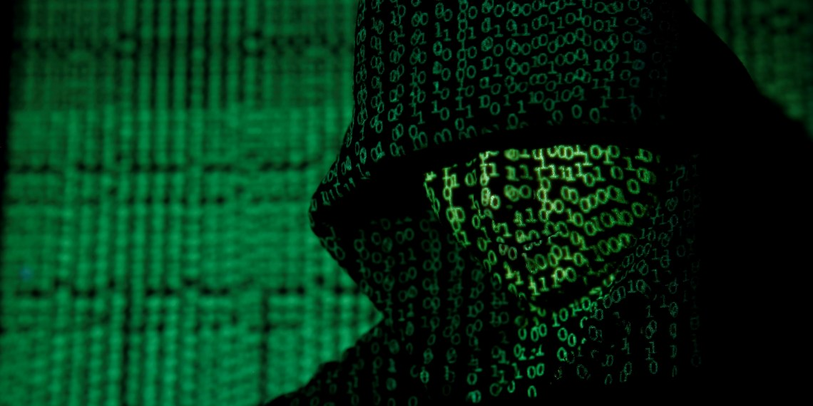 FILE PHOTO: A projection of cyber code on a hooded man is pictured in this illustration picture taken on May 13, 2017. REUTERS/Kacper Pempel