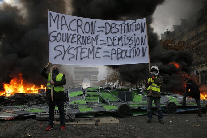 After the worst rioting in Paris in decades last weekend, many shops and restaurants in the center of the capital are expected to shut down Saturday, fearing a repeat of the violence. (File/AP/Michel Euler)