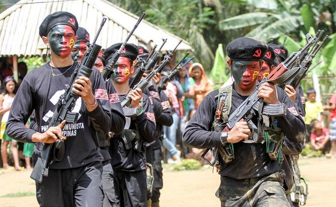 "Rebel attacks have stifled growth in resource-rich areas in the poor Southeast Asian country as guerrillas target mines, plantations, construction and telecommunication companies, demanding ""revolutionary taxation"" to finance their fight. (AFP)"