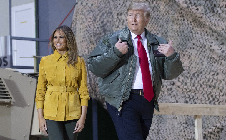 US President Donald Trump and First Lady Melania Trump arrive to speak to members of the US military during an unannounced trip to Al Asad Air Base in Iraq on December 26, 2018.