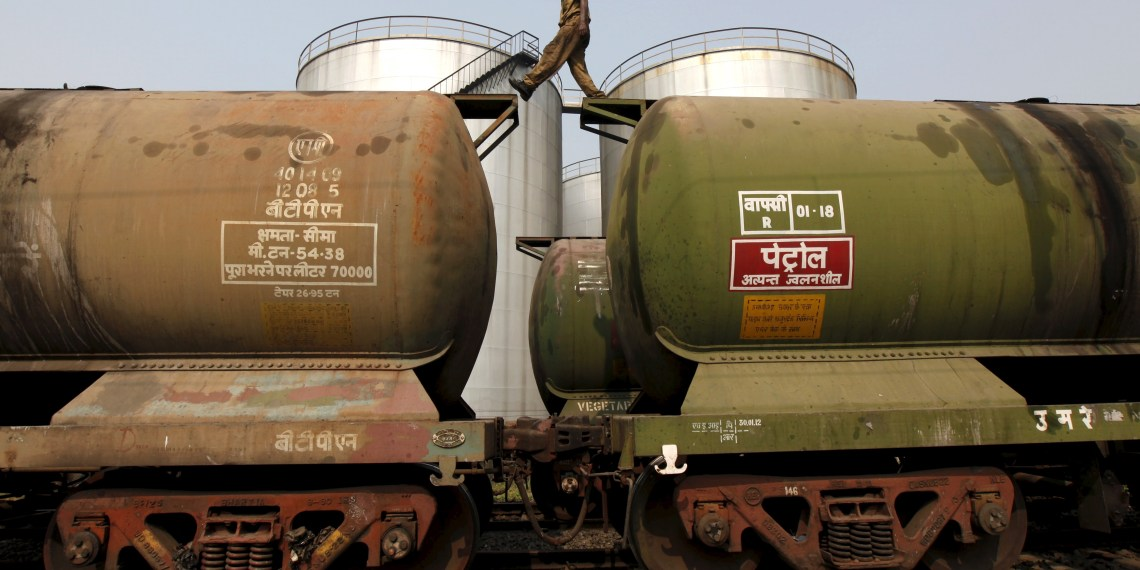 FILE PHOTO: A worker walks atop a tanker wagon to check the freight level at an oil terminal on the outskirts of Kolkata, India in this November 27, 2013. REUTERS/Rupak De Chowdhuri