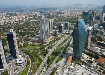 FILE PHOTO: Bussiness and financial district of Levent, which comprises leading Turkish companies' headquarters and popular shopping malls, is seen from the Sapphire Tower in Istanbul, Turkey May 3, 2016. Picture taken through a window. REUTERS/Murad Sezer