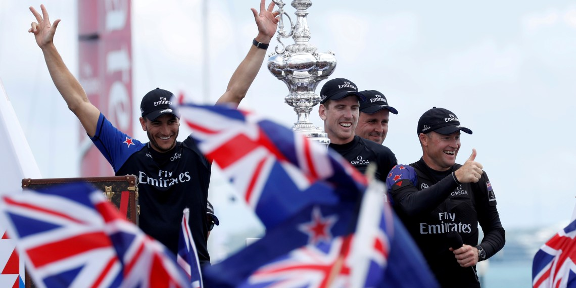 FILE PHOTO: Sailing - America's Cup finals - Hamilton, Bermuda - June 26, 2017 -  Emirates Team New Zealand celebrates with the America's Cup trophy after defeating Oracle Team USA.  REUTERS/Mike Segar/File Photo