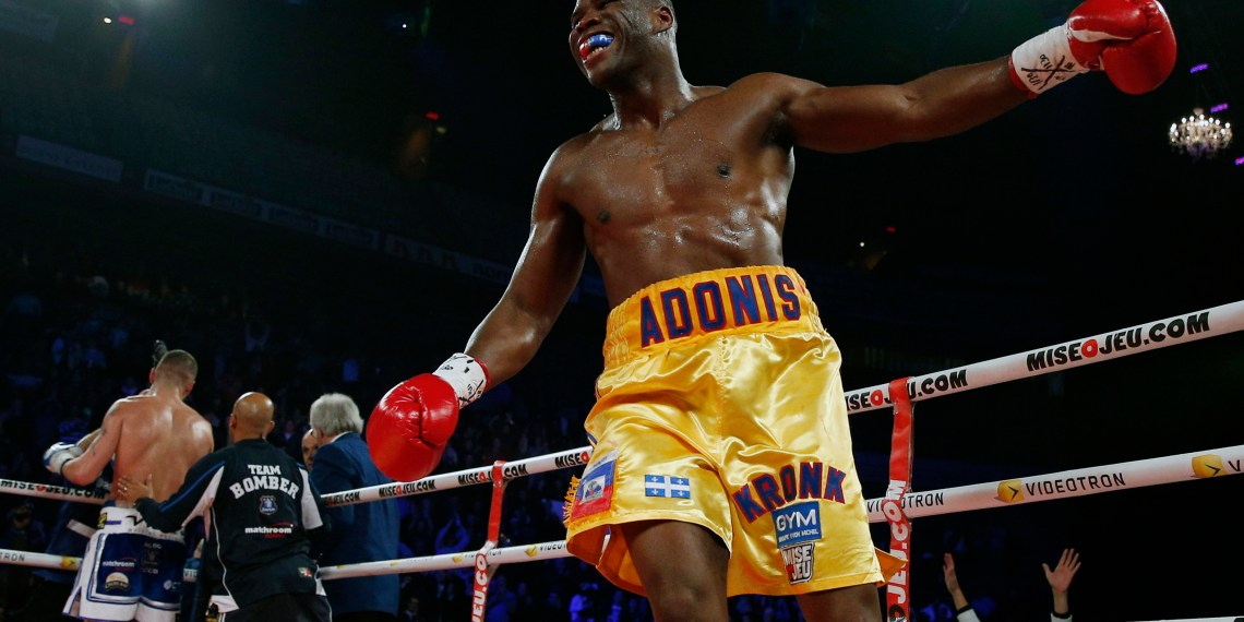FILE PHOTO: Adonis Stevenson of Canada celebrates after knocking out Tony Bellew of England (L) during their World Boxing Council (WBC) light heavyweight title boxing match at the Colisee in Quebec City, December 1, 2013. REUTERS/Mathieu Belanger